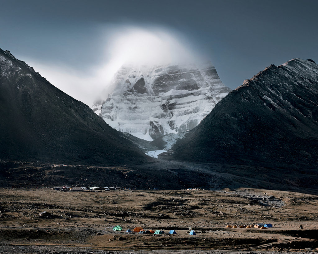 mount kailash -  tibet -  dirapuk gompa - kailash northface - 4890 m - left: avalokiteshavara hill - right: vajrapani hill pilgrims warshipping the holy mt. kailash (gang rinpoche) in western tibet. the mt. kailash is considered a sacred place in four religions: bön, buddhism, hinduism and jainism. pilgrims walk the kora (53 km long sacred circuit, highest pass at 5.700 m) around the mountain. tibetans believe that the entire walk should be made in a single day. some pilgrims are performing body-length prostrations over the entire length of the kora. it takes them about 3-4 weeks. mt. kailash (6.638 m) has never been climbed. it is one of the last spots on earth never  entered by men.